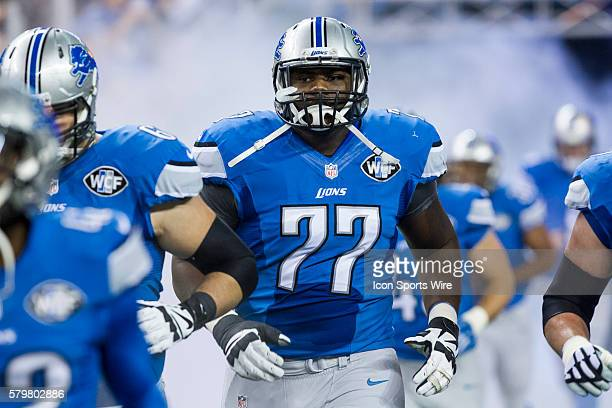 Detroit Lions offensive lineman Cornelius Lucas runs onto the field prior to the start of the game between the Chicago Bears and Detroit Lions during...