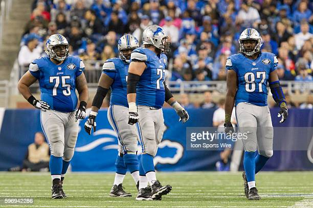 Detroit Lions offensive lineman Larry Warford Detroit Lions offensive lineman Cornelius Lucas and Detroit Lions tight end Brandon Pettigrew walk to...