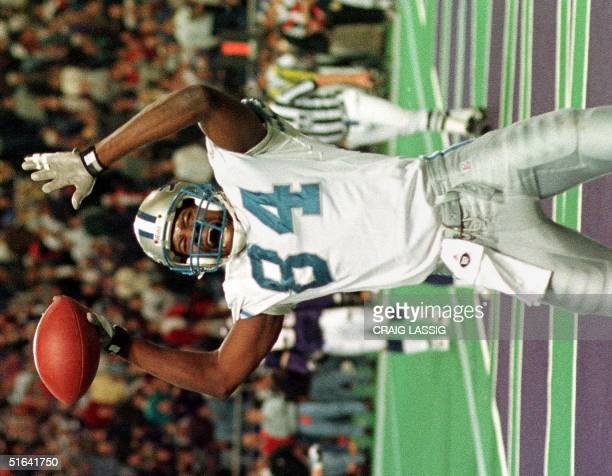 Detroit Lions player Herman Moore celebrates after catching the game-winning touchdown pass from quarterback Scott Mitchell in the final seconds of...