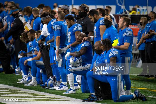 Detroit Lions players kneel during the national anthem before the first quarter at Ford Field on September 13 2020 in Detroit Michigan