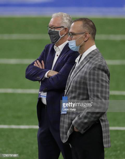Detroit Lions President and CEO Rod Wood talks with Chris Spielman prior to the start of the game against the Tampa Bay Buccaneers at Ford Field on...