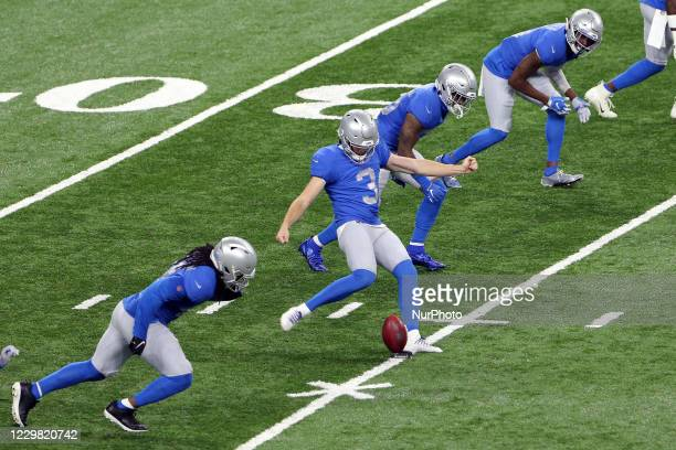 Detroit Lions punter Jack Fox kicks to the Houston Texans during the first half of an NFL football game between the Detroit Lions and the Houston...
