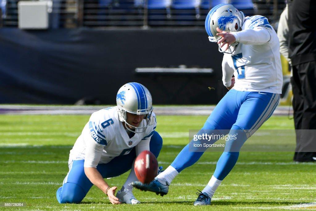 164e94d7a ... Nike Alternate Vapor Untouchable Detroit Lions punter Sam Martin (6)  holds the ball for kicker Matt Prater ...