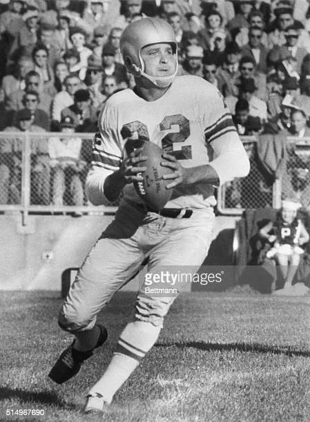 Detroit Lions quarterback Bobby Layne gets ready to throw the ball during a game against the Green Bay Packers