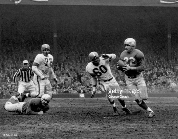 Detroit Lions quarterback Bobby Layne looks to pass in a 1716 win over the Cleveland Browns in a League Championship game on December 27 1953 at...