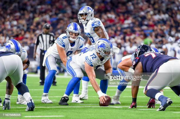 Detroit Lions quarterback David Fales gets ready to take a snap from center Luke Bowanko during a NFL preseason game between the Detroit Lions and...