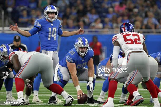 Detroit Lions quarterback Jake Rudock and Detroit Lions offensive guard Graham Glasgow in the lineup during the first half of an NFL football game...