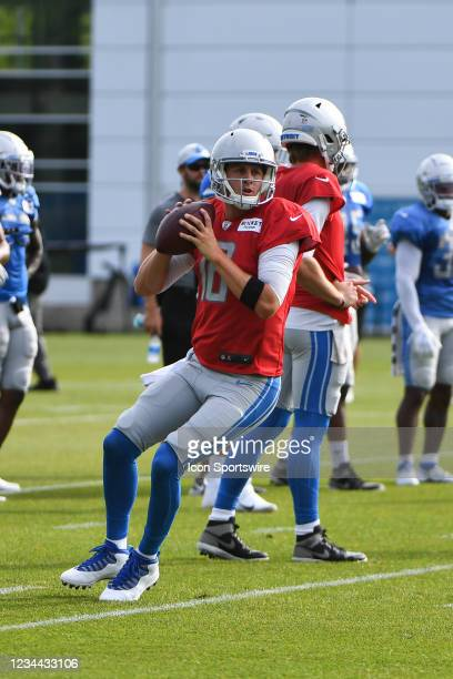 Detroit Lions quarterback Jared Goff drops back to pass during the Detroit Lions preseason OTA practice on Tuesday August 3, 2021 at Comerica Park in...