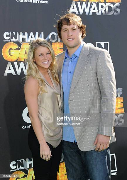 Detroit Lions quarterback Matthew Stafford and Kelly Hall arrives at Cartoon Network Hall of Game Awards held at The Barker Hanger on February 21...
