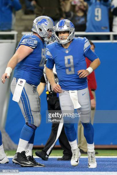 Detroit Lions quarterback Matthew Stafford celebrates his two point conversion pass during the second half of an NFL football game against the Green...