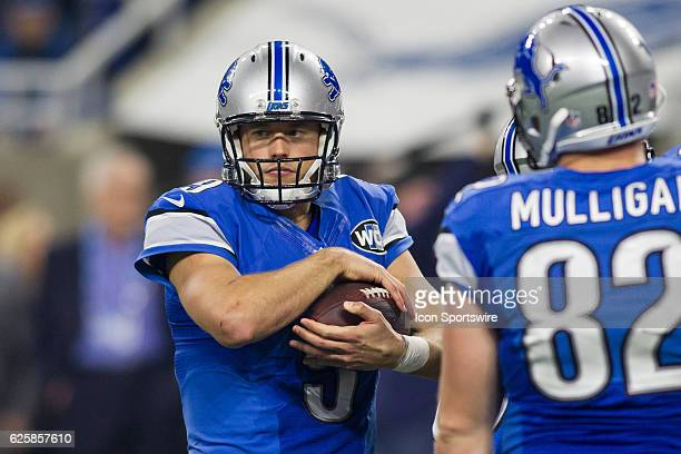 Detroit Lions quarterback Matthew Stafford cradles the ball during game action between the Minnesota Vikings and the Detroit Lions on Thanksgiving...