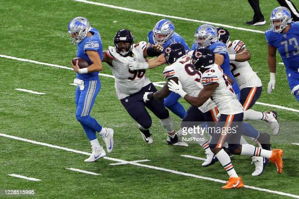 Detroit Lions quarterback Matthew Stafford is sacked by Chicago Bears defense during the second half of an NFL football game against the Chicago...
