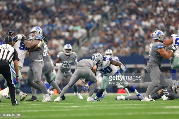 Detroit Lions quarterback Matthew Stafford is sacked by Dallas Cowboys defensive end Demarcus Lawrence during the game between the Detroit Lions and...