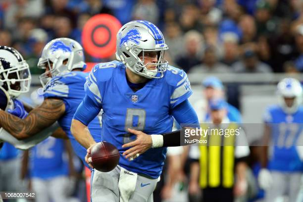 Detroit Lions quarterback Matthew Stafford looks to hand off the ball during the second half of an NFL football game against the Los Angeles Rams in...