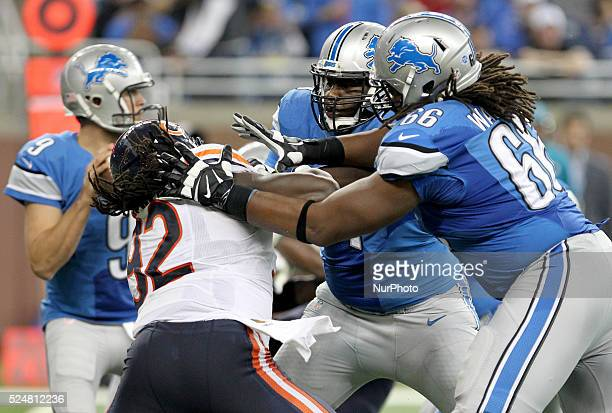 Detroit Lions quarterback Matthew Stafford looks to pass as tackle Cornelius Lucas and tackle LaAdrian Waddle stops Chicago Bears outside linebacker...