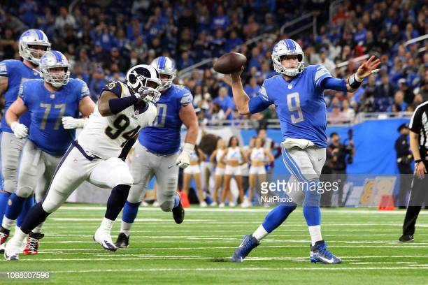 Detroit Lions quarterback Matthew Stafford passes under the pressure of Los Angeles Rams DL John FranklinMyers during the second half of an NFL...