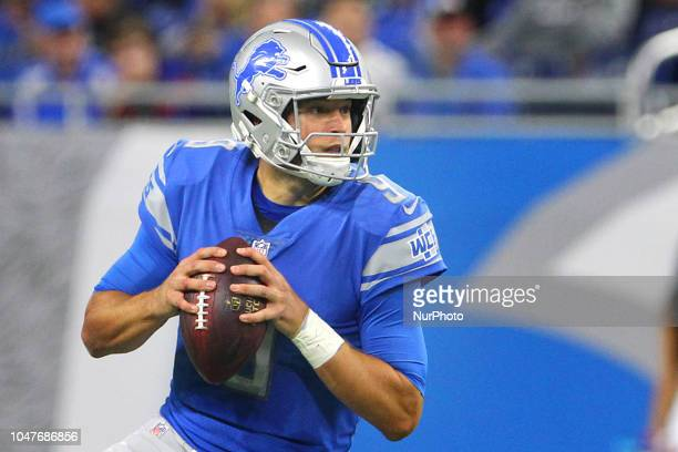 Detroit Lions quarterback Matthew Stafford prepares to pass during the first half of an NFL football game against the Green Bay Packers in Detroit...