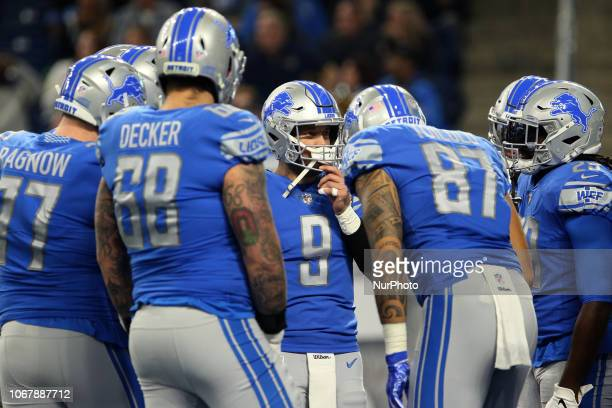 Detroit Lions quarterback Matthew Stafford talks to his teammates during the first half of an NFL football game against the Los Angeles Rams in...