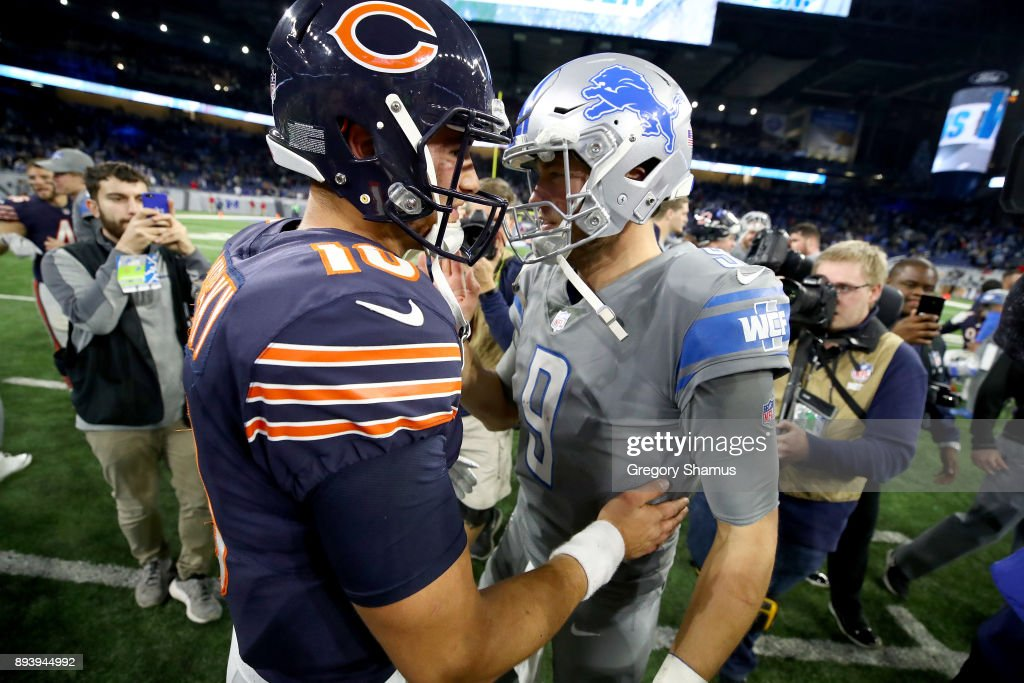 Detroit Lions quarterback Matthew Stafford #9 talks with Chicago Bears quarterback Mitchell Trubisky #10 after the Lions defeated the Bears20-10 at Ford Field on December 16, 2017 in Detroit, Michigan.