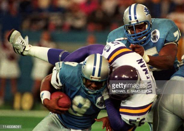 Detroit Lions Quarterback Rodney Pete gets sacked by Minnesota Vikings Chris Doleman as the Lions Lomas Brown tries to help in the second quarter of...