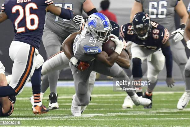 Detroit Lions RB Theo Riddick gets tackled after a short run in the NFL game between Chicago Bears and Detroit Lions on December 16 2017 at Ford...