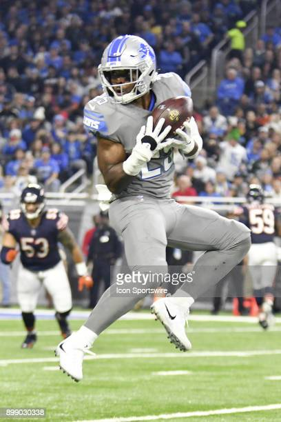 Detroit Lions RB Theo Riddick jumps to make a catch in the NFL game between Chicago Bears and Detroit Lions on December 16 2017 at Ford Field in...