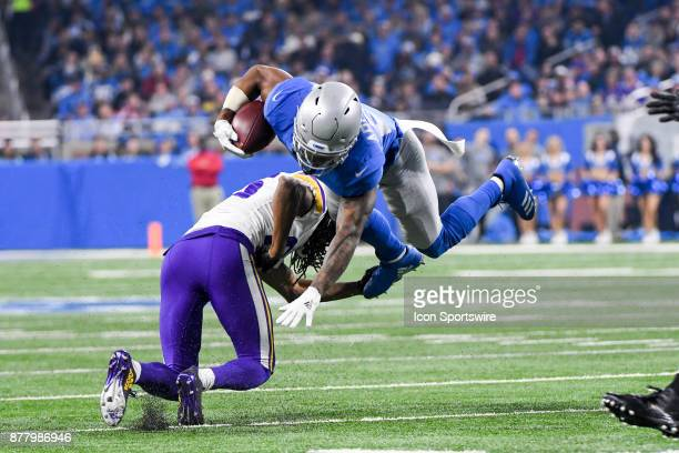 Detroit Lions running back Ameer Abdullah is upended by Minnesota Vikings cornerback Trae Waynes during the Detroit Lions game versus the Minnesota...