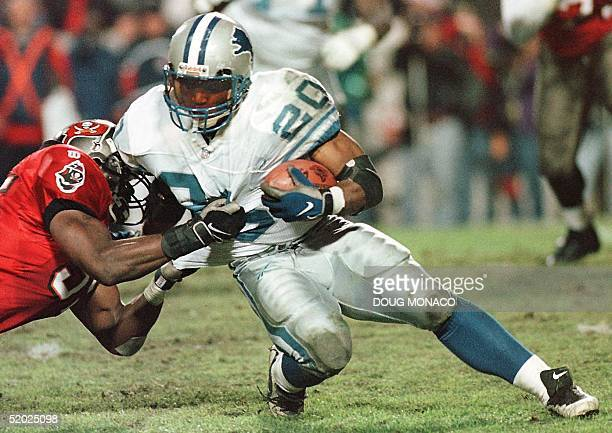 Detroit Lions running back Barry Sanders is stopped by Derrick Brooks of the Tampa Bay Buccaneers 28 December during their NFC Wild Card playoff game...