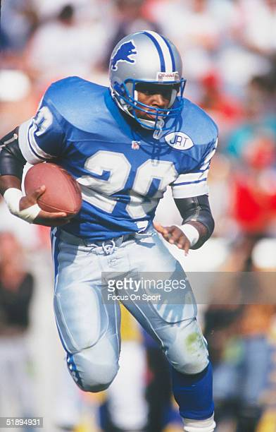 Detroit Lions' running back Barry Sanders runs the ball during a game