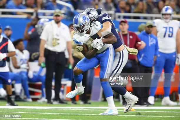 Detroit Lions running back Bo Scarbrough carries the ball under the pressure of Dallas Cowboys outside linebacker Leighton Vander Esch during the...