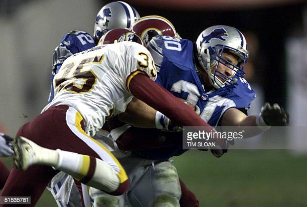 Detroit Lions' running back Cory Schlesinger is tackled in the first half during their first-round NFC playoff game against the Washington Redskins...