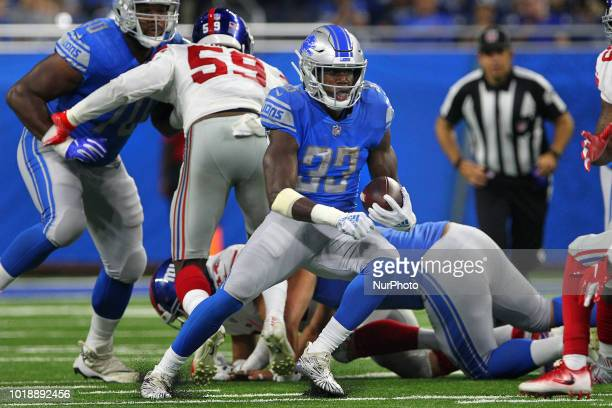 Detroit Lions running back Kerryon Johnson carries the ball during the second half of an NFL football game against the New York Giants in Detroit...