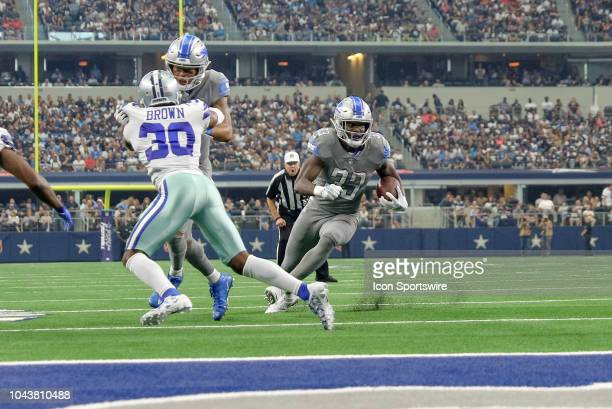Detroit Lions running back Kerryon Johnson cuts back and scores a touchdown during the game between the Detroit Lions and Dallas Cowboys on September...