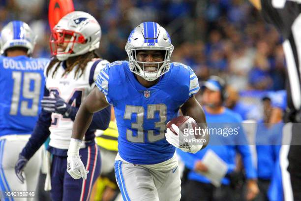 Detroit Lions running back Kerryon Johnson reacts after making a down during the first half of an NFL football game against the New England Patriots...