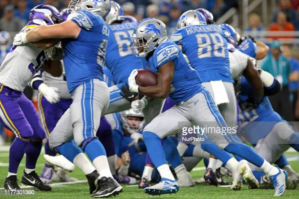 Detroit Lions running back Kerryon Johnson runs the ball during the first half of an NFL football game against the Minnesota Vikings in Detroit...