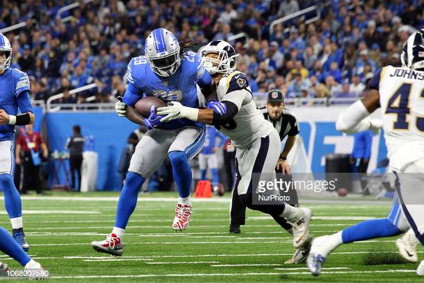 Detroit Lions running back LeGarrette Blount attempts to run the ball under the defense of Los Angeles Rams defensive tackle Aaron Donald during the...