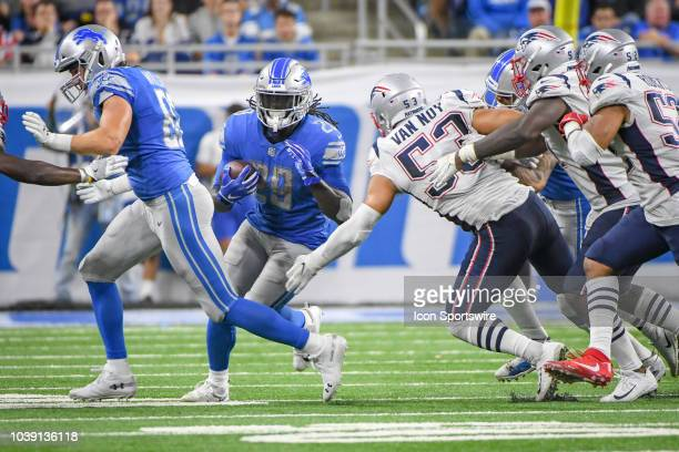 Detroit Lions running back LeGarrette Blount runs through the middle of the line during the Detroit Lions game versus the New England Patriots on...