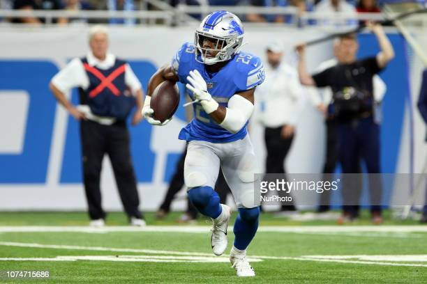 Detroit Lions running back Theo Riddick carries the ball during the first half of an NFL football game against the Minnesota Vikings in Detroit...