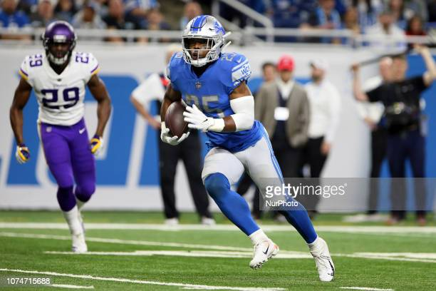 Detroit Lions running back Theo Riddick carries the ball under pressure from Minnesota Vinkings defense during the first half of an NFL football game...