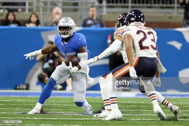 Detroit Lions running back Theo Riddick carries the ball under the pressure of Chicago Bears defense during the first half of an NFL football game...