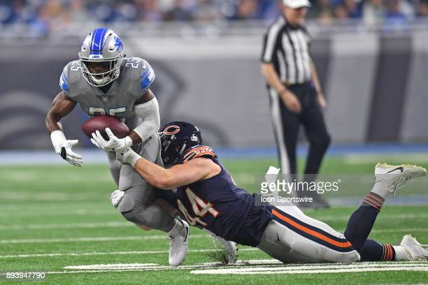 Detroit Lions running back Theo Riddick gains yardage as Chicago Bears inside linebacker Nick Kwiatkoski completes the tackle during a game between...