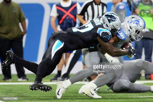 Detroit Lions running back Theo Riddick is sacked by Carolina Panthers defensive end Mario Addison during the first half of an NFL football game...