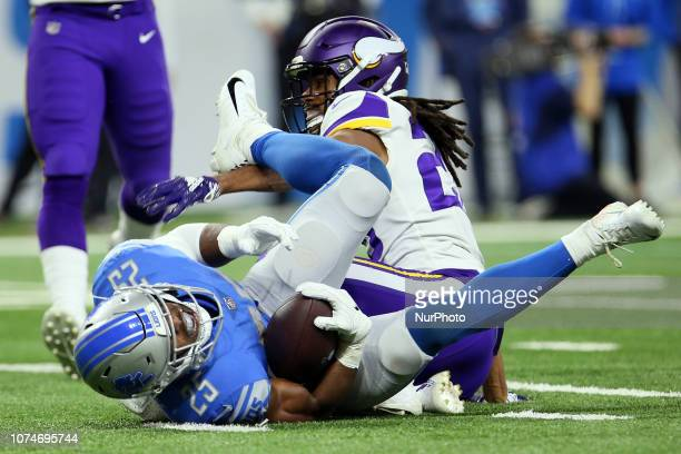 Detroit Lions running back Theo Riddick is sacked by Minnesota Vikings cornerback Trae Waynes during the first half of an NFL football game against...