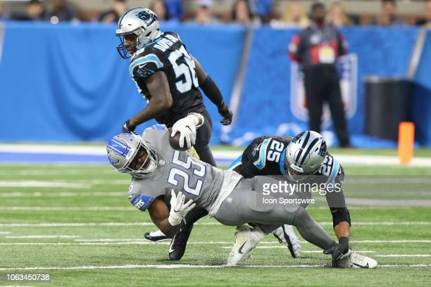 Detroit Lions running back Theo Riddick is tackled by Carolina Panthers safety Eric Reid during a regular season game between the Carolina Panthers...