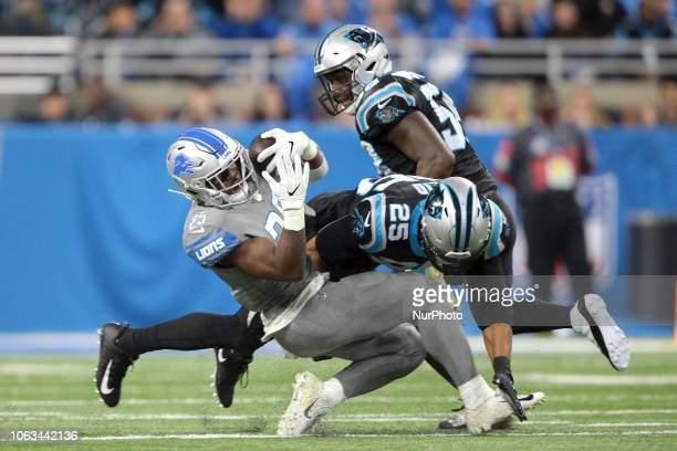 Detroit Lions running back Theo Riddick is tackled by Carolina Panthers strong safety Eric Reid during the second half of an NFL football game in...