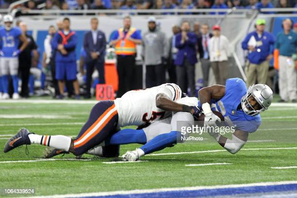 Detroit Lions running back Theo Riddick is tackled by Chicago Bears inside linebacker Roquan Smith during the second half of an NFL football game in...