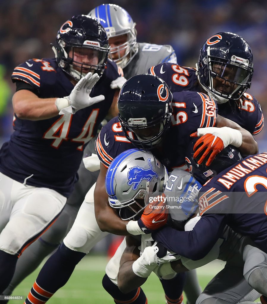 Detroit Lions running back Theo Riddick #25 is tackled by Chicago Bears during the first half at Ford Field on December 16, 2017 in Detroit, Michigan.
