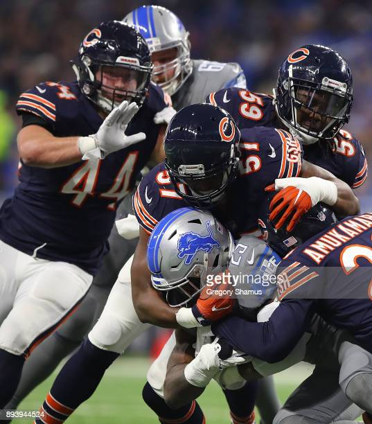 Detroit Lions running back Theo Riddick is tackled by Chicago Bears during the first half at Ford Field on December 16 2017 in Detroit Michigan