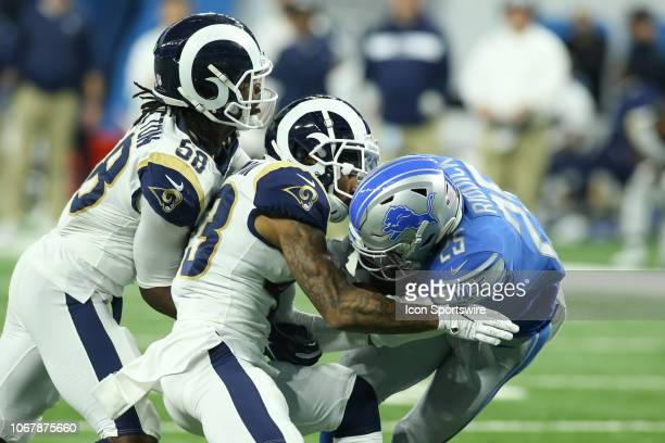 Detroit Lions running back Theo Riddick is tackled by Los Angeles Ram safety John Johnson III and Los Angeles Ram linebacker Cory Littleton during a...