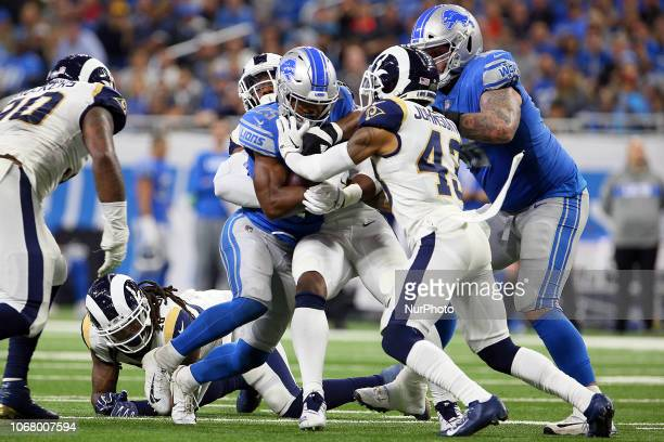 Detroit Lions running back Theo Riddick is taken down by Los Angeles Rams inside linebacker Mark Barron Los Angeles Rams linebacker Dante Fowler and...